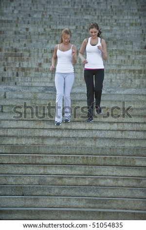 Caucasian women doing workout outside - stock photo