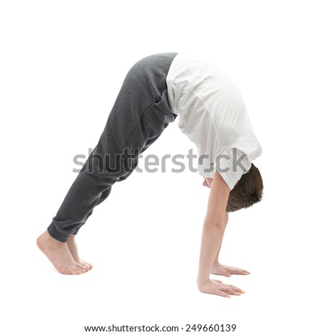 Caucasian 12 years old childen boy in a white t-shirt stretching or doing yoga. Composition isolated over the white background - stock photo