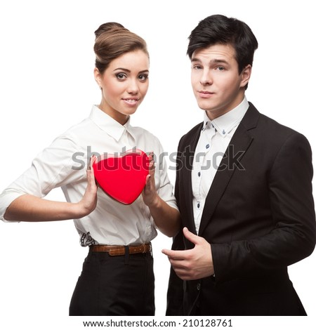 caucasian young business people holding red heart isolated on white - stock photo