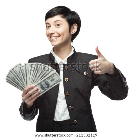 caucasian young business woman holding money and showing thumbs up. isolated on white - stock photo