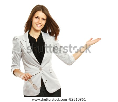 Caucasian young female mode in suit pointing at something. - stock photo