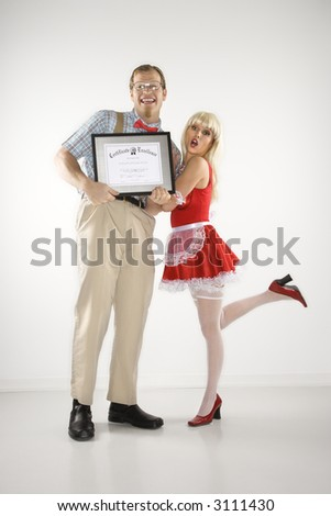 Caucasian young man dressed like nerd holding certificate with Caucasian young blonde woman dressed in french maid outfit. - stock photo