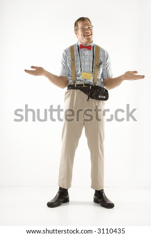 Caucasian young man dressed like nerd shrugging his shoulders. - stock photo