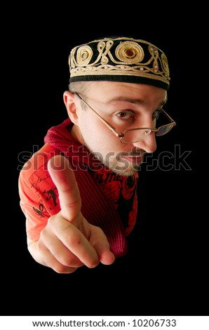 caucasian young man gesturing over black background - stock photo