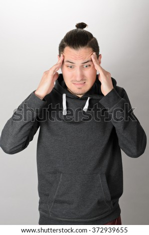 Caucasian Young Man with Beard Thinking Doubting and Considering a Decision - stock photo