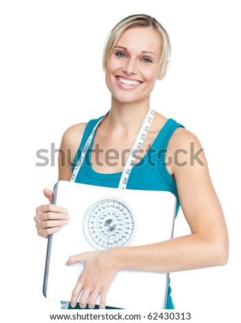 Caucasian young woman holding a weight scale looking at the camera over white background - stock photo