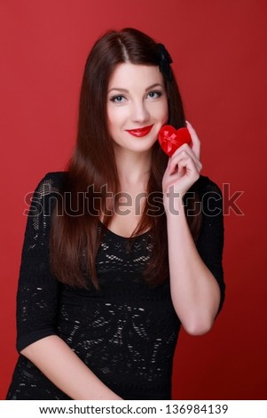 Caucasian young woman holding red velvet heart shape jewelry box on holiday theme - stock photo