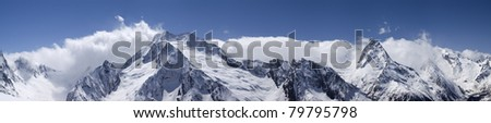 Caucasus Mountain panorama. Region Dombay. View from the ski slope. - stock photo