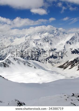 Caucasus Mountains. Gorge Irik Chat. Snowy plateau - stock photo