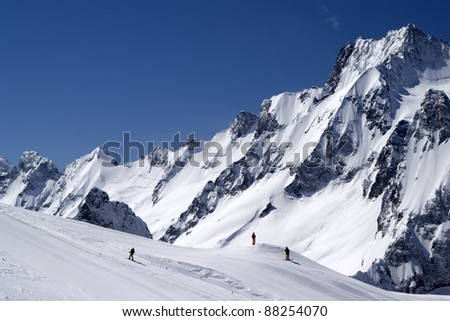 Caucasus Mountains, ski slope at ski resort Dombay. - stock photo