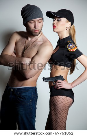 Caught robber and police girl, close up studio shot - stock photo
