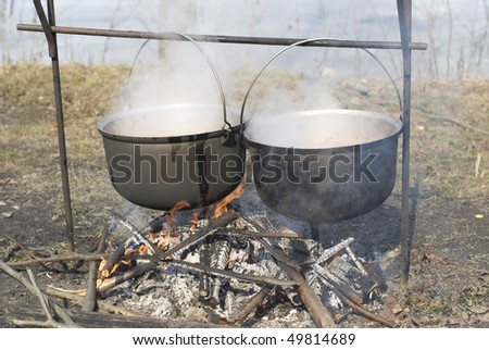 cauldron on the fire - stock photo