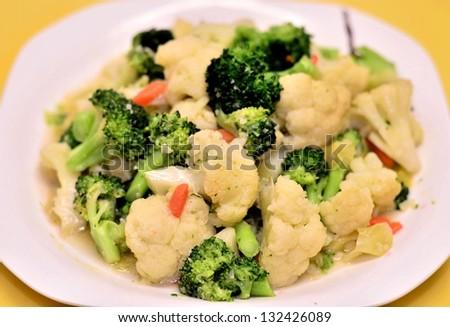 Cauliflower and green broccoli dish - stock photo