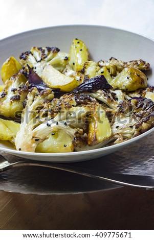 Cauliflower and potatoes fried with black cumin - stock photo