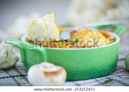 cauliflower baked with egg and cheese with dill - stock photo