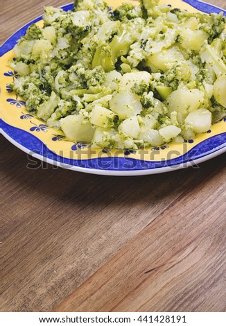 Cauliflower dish on a rustic wooden table. Typical dish of Mediterranean diet. - stock photo