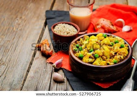 cauliflower green peas turmeric rice on a wood background. toning. selective focus