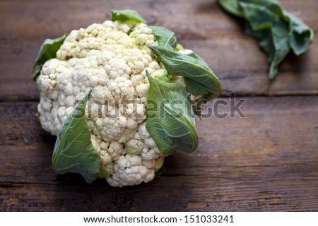 Cauliflower on the wooden board - stock photo