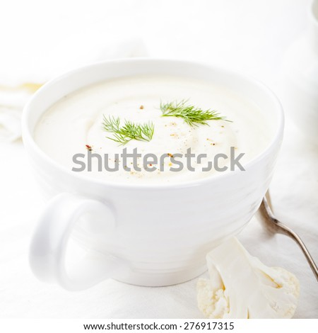 Cauliflower soup with dill and seasoning on a white background. Healthy food - stock photo