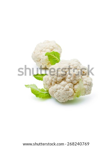 Cauliflower. Two fresh ripe whole cauliflower cabbages close-up isolated on white background - stock photo