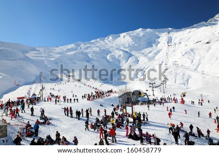 Cauterets ski resort is photographed in plain season. There are many skiers on the snowy slopes at the Cirque du Lys.  - stock photo