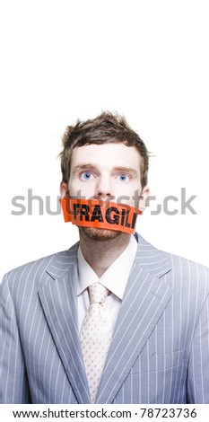 Caution Beware Of The Stressed And Dangerous Business Man Or Businessman Wearing Fragile Packing Tape Across Face In A Postage Packing And Delicate Mail Concept