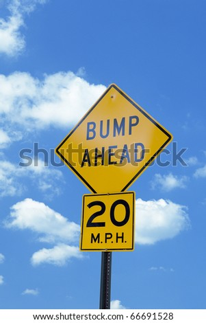 Caution bumps ahead sign with the blue sky - stock photo