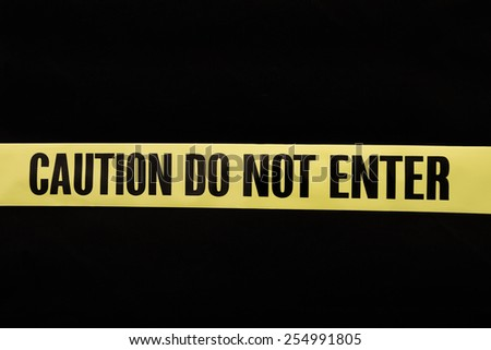 Caution Do Not Enter Tape with black background - stock photo