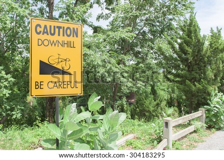 Caution downhill sign - stock photo