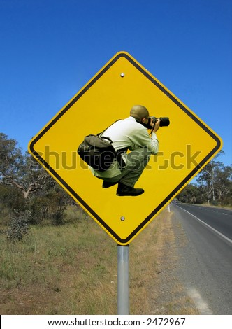 Caution photographers ahead. Funny road sign against the blue sky. - stock photo