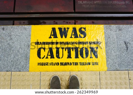 CAUTION sign at the floor