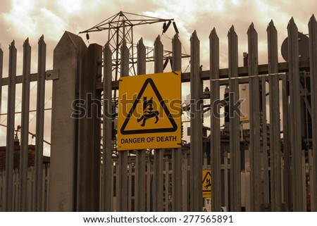 Caution Sign: Danger of Death - stock photo