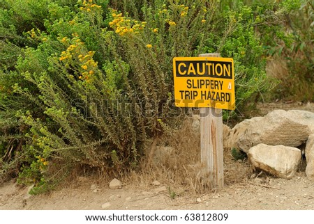 Caution Sign on Hiking Trail - stock photo