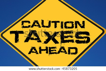 "Caution sign reading ""Caution Taxes Ahead"" - stock photo"