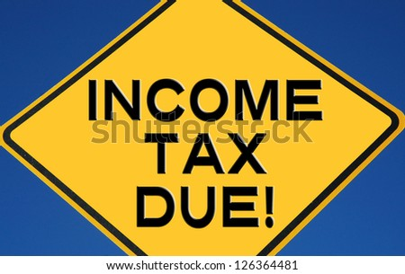 "Caution sign reading ""Income Tax Due"" - stock photo"