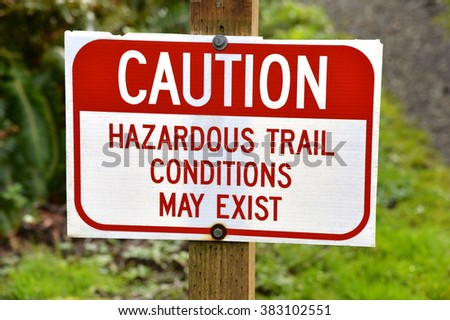 caution sign stating that hazardous trail conditions exist ahead