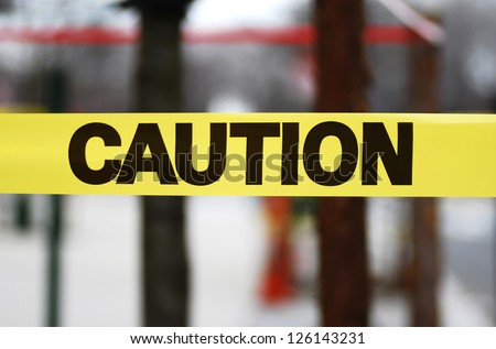 Caution sign tape concept of warning and danger - stock photo