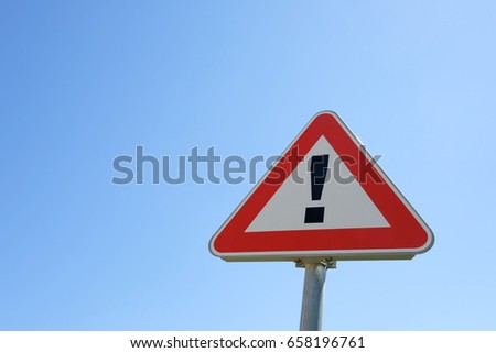 Caution sign with clearly sky on the background