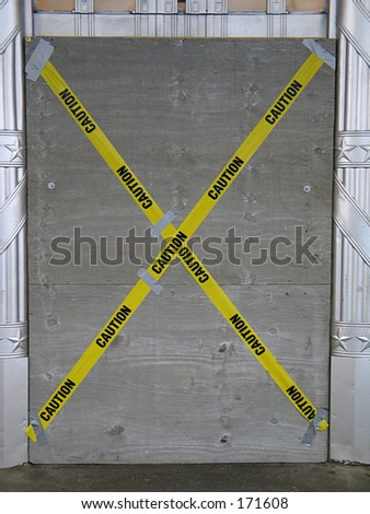 "caution tape on door, ""bad company decision"" - stock photo"