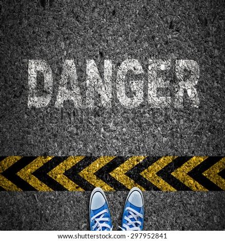 Caution tape over asphalt background, Warning sign, Danger sign. - stock photo