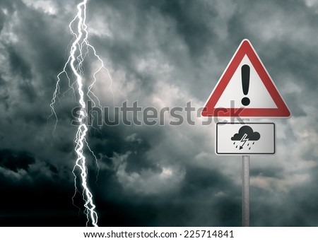 Caution - Thunderstorm Ahead - A dark cloudy sky with a lightning bolt and a warning sign in the foreground  - computer generated image - stock photo