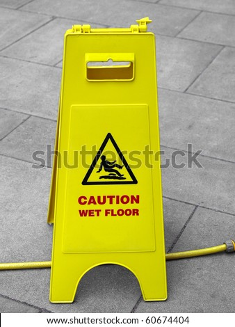 Caution wet floor and slippery surface sign - stock photo