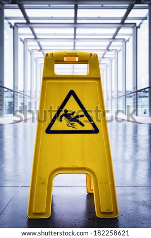 caution wet floor sign at a corridor - stock photo