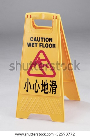 Caution wet floor sign isolated on clean background.
