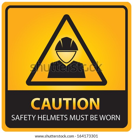 Caution with safety helmets must be worn text and sign isolated.JPG - stock photo