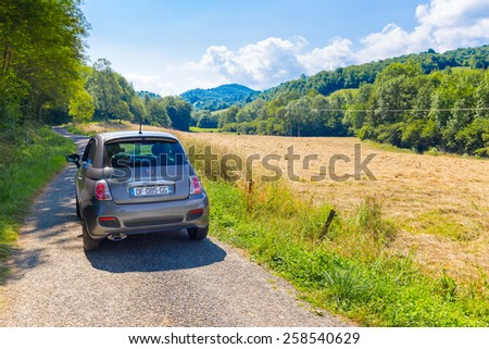 CAVAZET, FRANCE - JULY 24, 2014: Fiat 500 (Type 312) parked in the French country side at Cavazet in the Midi Pyrenees. The Fiat 500 hatchback is a city car built by Italian automaker Fiat since 2007. - stock photo