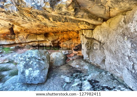 Cave among amazing rock formations. Shot in Krakadouw, Cederberg Mountains, near Clanwilliam, Western Cape, South Africa. - stock photo