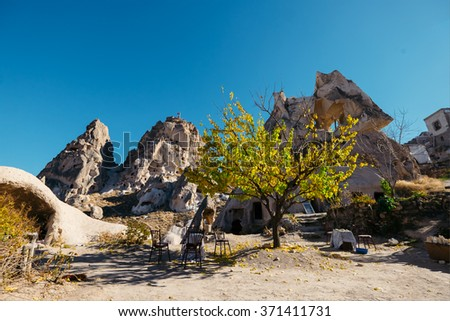 Cave dwelling and columbariums at the valley of Uchisar town. Cappadocia, Turkey. - stock photo