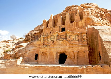 Cave dwellings in the lost city of Petra, Jordan. Petra is one of the new Seven Wonders of the World and is also referred to as the Rose-Red city due to the colour of the rocks. - stock photo