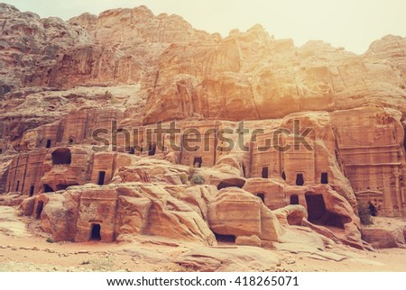 Cave dwellings in the Rose City of Petra, Jordan. The city of Petra was lost for over 1000 years. Now one of the Seven Wonders of the Word - stock photo